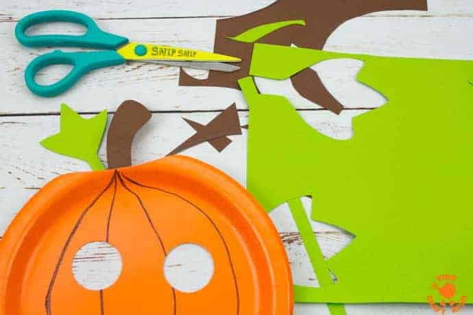 Paper Plate Pumpkin Lacing Craft Step 4