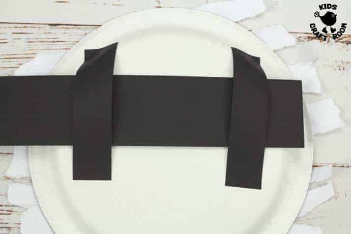 Step 6 Moving Eyes Paper Plate Mummy Craft