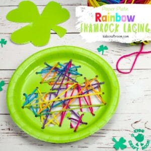 This paper plate St Patrick's Day Shamrock Lacing Craft is fun for kids to practise fine motor skills as they lace and sew a colourful rainbow shamrock leaf! An easy St Patrick's Day craft for kids. Paper plate crafts are so fun! #kidscraftroom #shamrock #stpatricksdaycrafts #stpatricksdaydecorations #paperplatecrafts #kidscrafts #preschoolcrafts