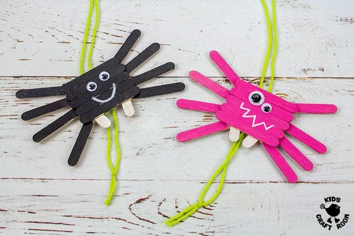 Climbing Popsicle Stick Spider Craft finished in pink