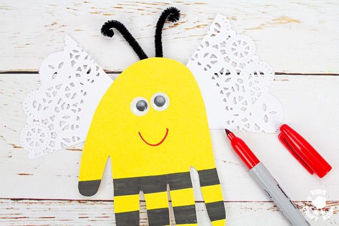Handprint Bee Puppet Craft step 7