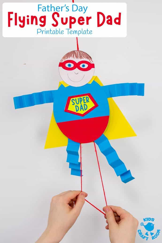 Suspended Father's Day Flying Super Dad craft with child's hands pulling the strings to make it fly.