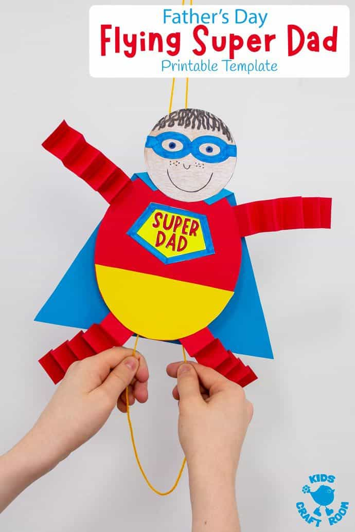 Flying Super Dad Craft with a child's hands pulling the string to make it fly.