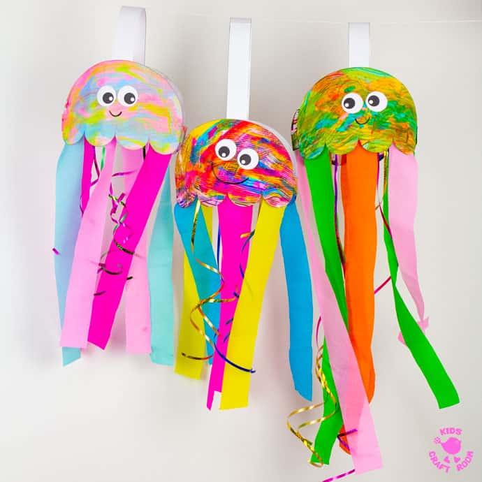 Scrape Painted Jellyfish Windsock Craft pin image 2. Three jellyfish windsocks hanging on a string.