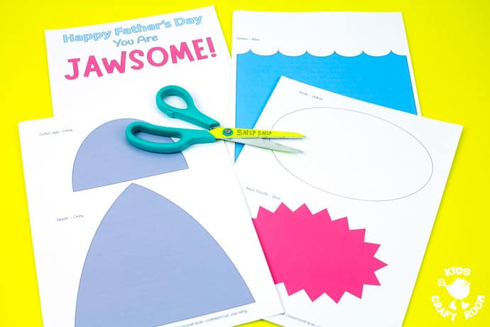 Shark Father's Day Card templates on a yellow table top. Step 1.