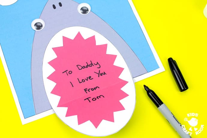Shark Father's Day Card on a yellow table top. Step 10.