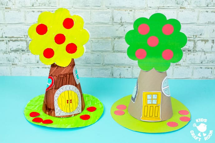 Apple Tree Fairy House Craft sitting on a blue table top.