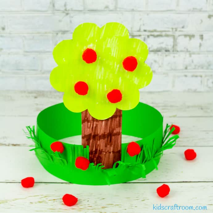 Apple Tree Hat Craft on white table top.