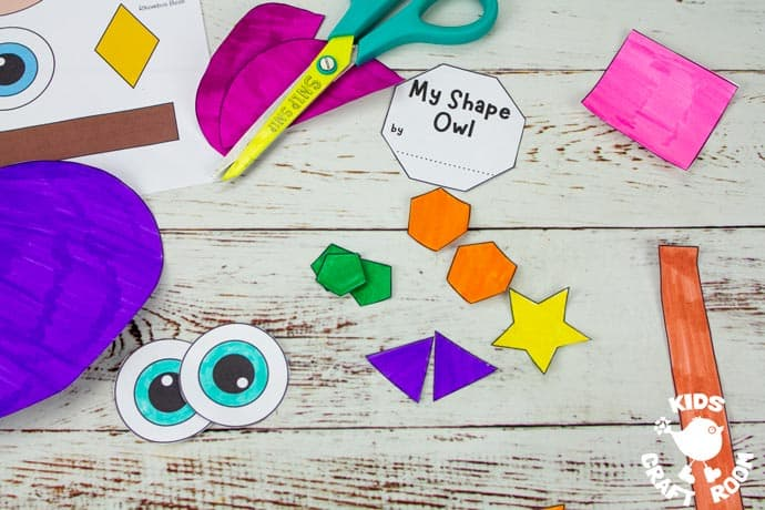 Shape Owl Craft template with the pieces coloured in and cut out.