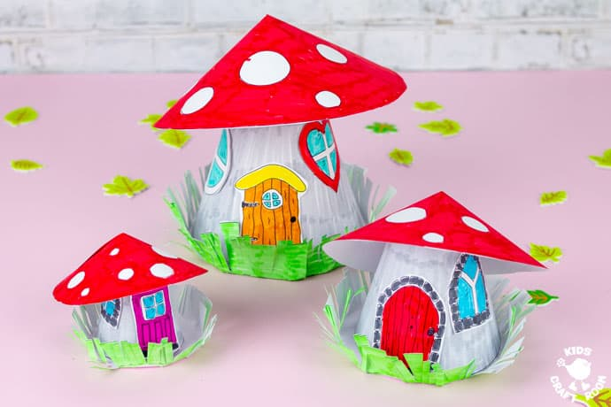 Mushroom Fairy House Craft finished and displayed on a pink table top in three sizes.