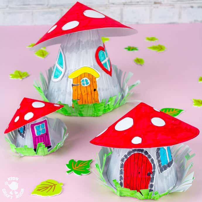 Mushroom Fairy House Craft square image of three fairy houses on a pink table top.