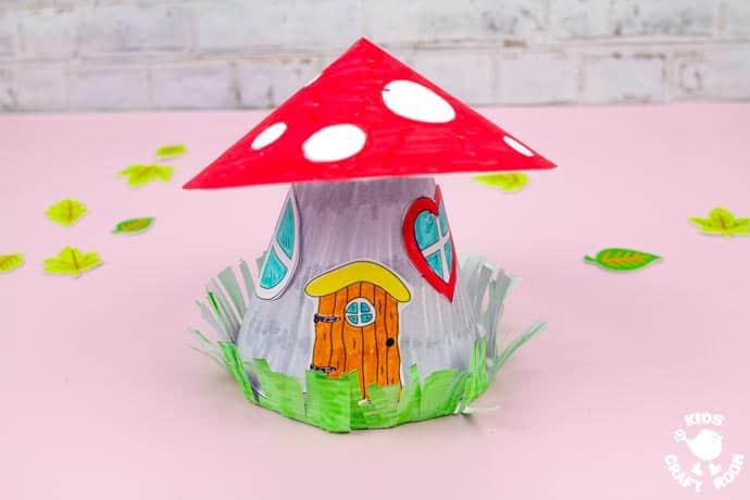 Mushroom Fairy House Craft on a pink table top.