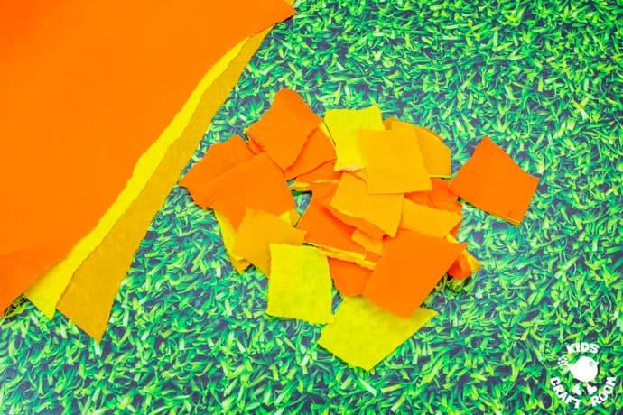 Paper Plate Pumpkin Wreath Craft step 2.