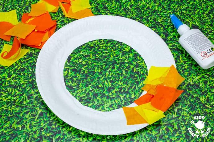 Paper Plate Pumpkin Wreath Craft step 3.