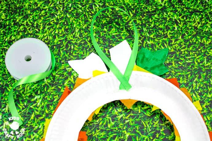Paper Plate Pumpkin Wreath Craft step 7.